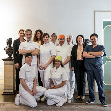 Group photo of Dr. Calesini and emplyees