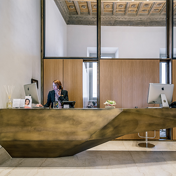 Contemporary front desk with receptionist