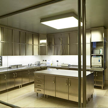 Room filled with stainless steel cabinetry