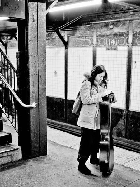 Girl and Guitar in the NY Subway